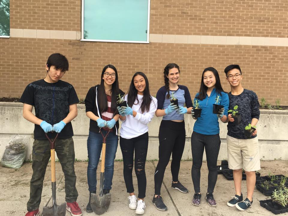 Marc Garneau CI students prepare to plant their pollinator garden.